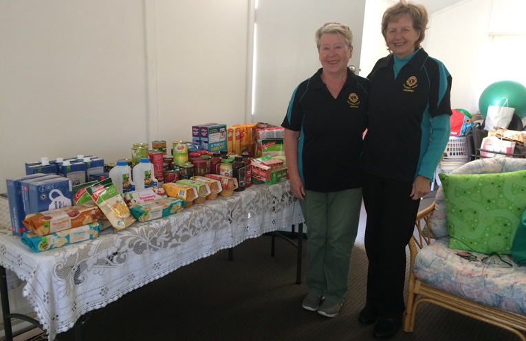 Lions Sharon Blunt and Virginia Andrews with the clubs food donation for May.
