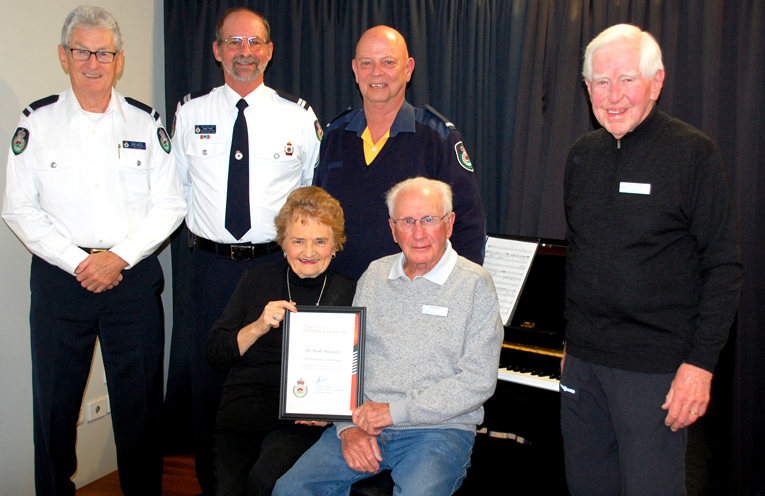 Standing, from the RFS, Noel Quince, Deputy Captain;  Ralph Clark, Senior Deputy Captain & Maurie Leembruggen, Deputy Captain with Ray Hosking, President,  The Myall Melodians.   Seated are Margaret Rowden, Musical Director with Joe Kennelly, Treasurer for The Myall Melodians.