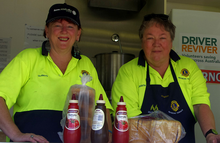 Raymond Terrace Lions Glenys Francis and Judith Bee offering up a healthy serve of stop revive and survive at a Driver Reviver.