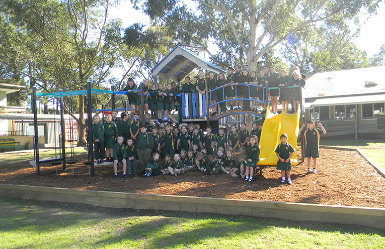 Students and staff celebrating the opening of the new playground at Salt Ash Public School.