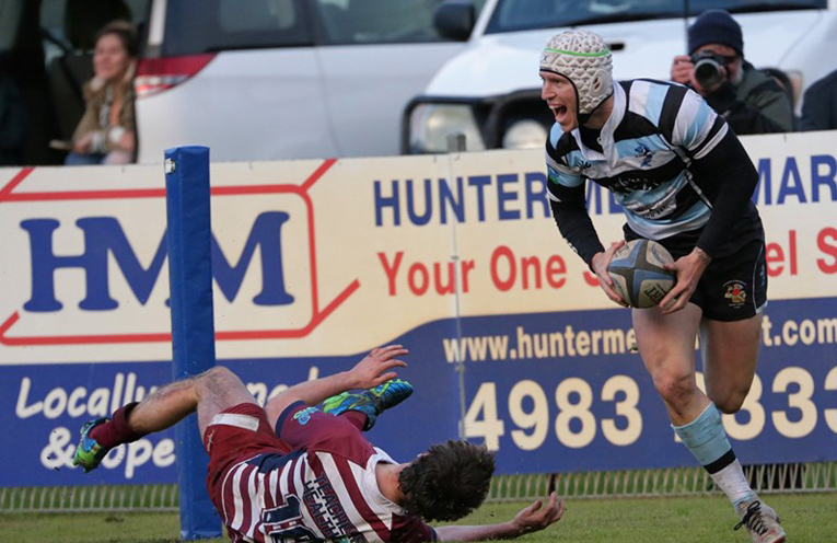 Emerson 'Baby John' Burgess crosses to seal victory for the Gropers. Photo courtesy of Gropers Facebook.
