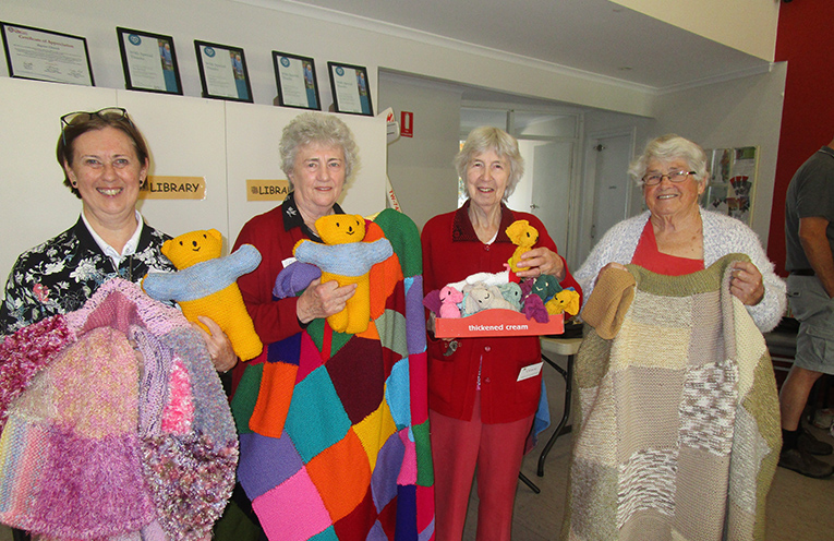 Eve Lauter, Carol Hewatt, Grace Oldfield, Jennifer Wenham displaying the wonderful array of  hand-made donations.