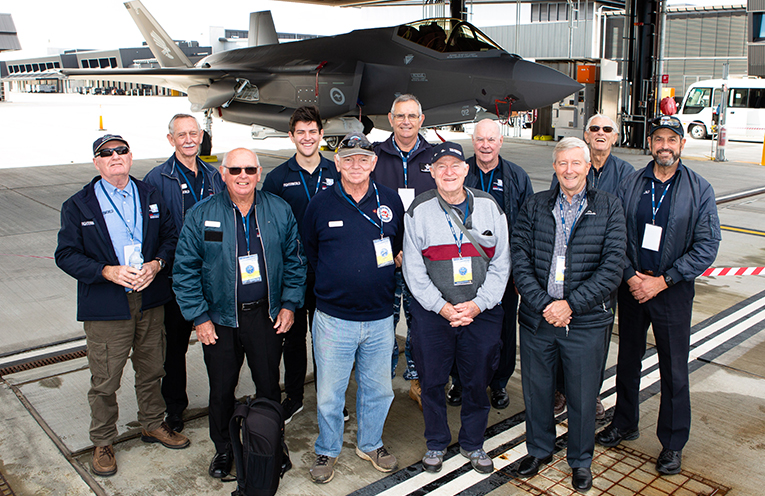 Fighter World staff take the opportunity to look over an F-35A Joint Strike Fighter during an F-35A Community Day at RAAF Base Williamtown. Photo 4 SGT Guy Young.