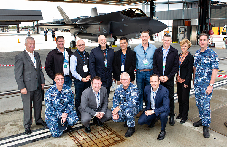 Local community members from the Hunter Defence Support Network join RAAF Base Williamtown Senior Australian Defence Force Officer Group Captain Peter Cluff (right) during an opportunity to look over an F-35A Joint Strike Fighter at RAAF Base Williamtown. Photo by SGT Guy Young.
