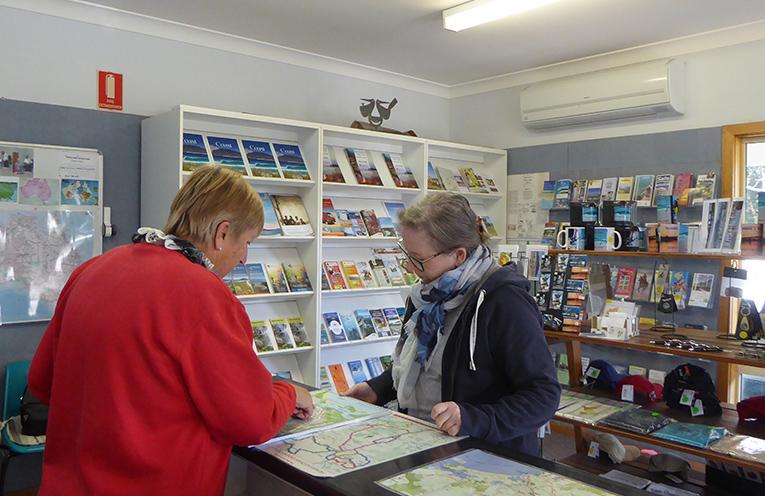 Bev Dunn showing map details to Margaret Lyall.