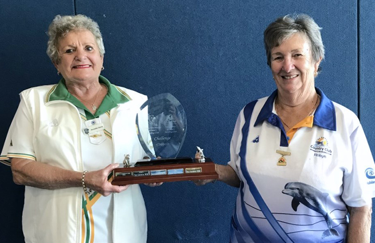 Annette Davis receiving the Trophy from Robyn Webster.